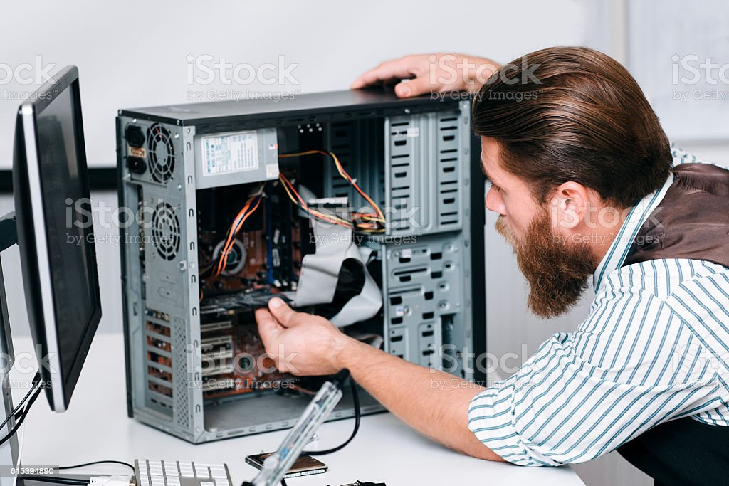 Engineer fixing circuit in disassembled CPU stock photo