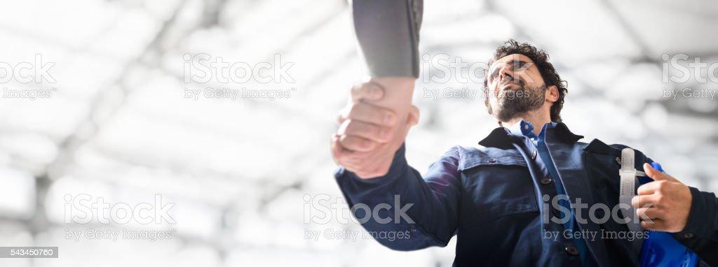 Engineer giving an handshake stock photo