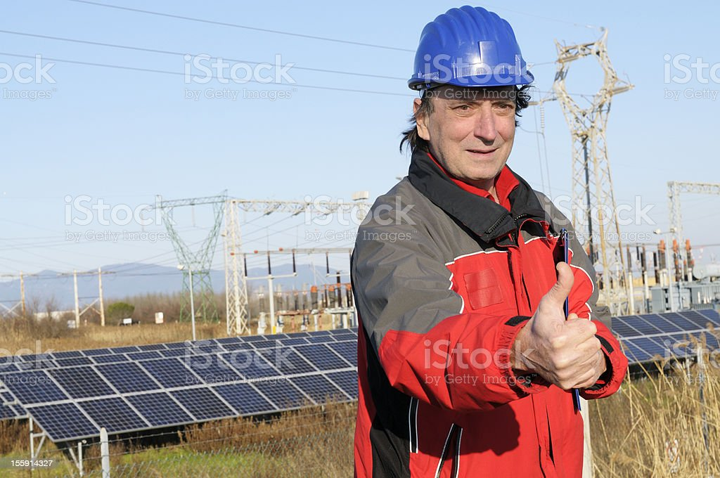 Engineer Giving Thumb Up in a Solar Power Station royalty-free stock photo
