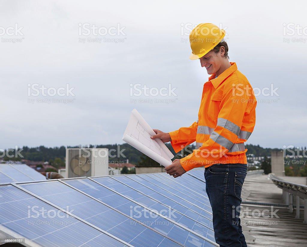 Engineer Holding Blueprint stock photo