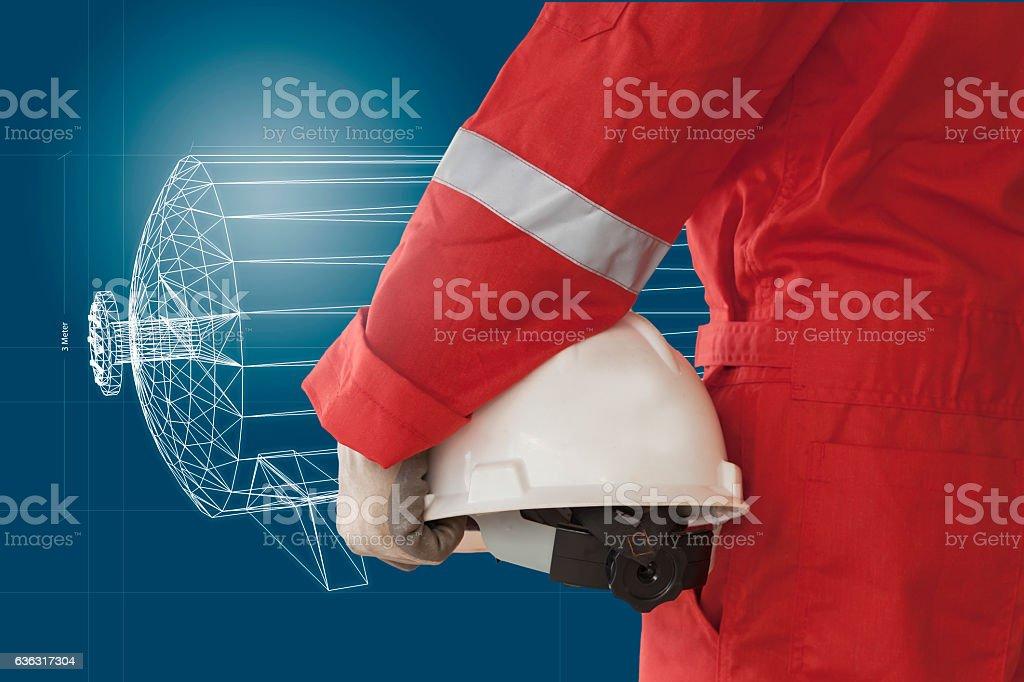 Engineer holding hetmet on isolate drawing background stock photo