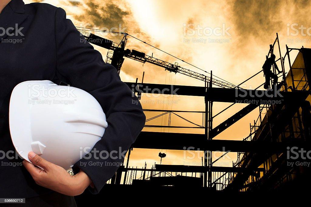 engineer holding white helmet stock photo