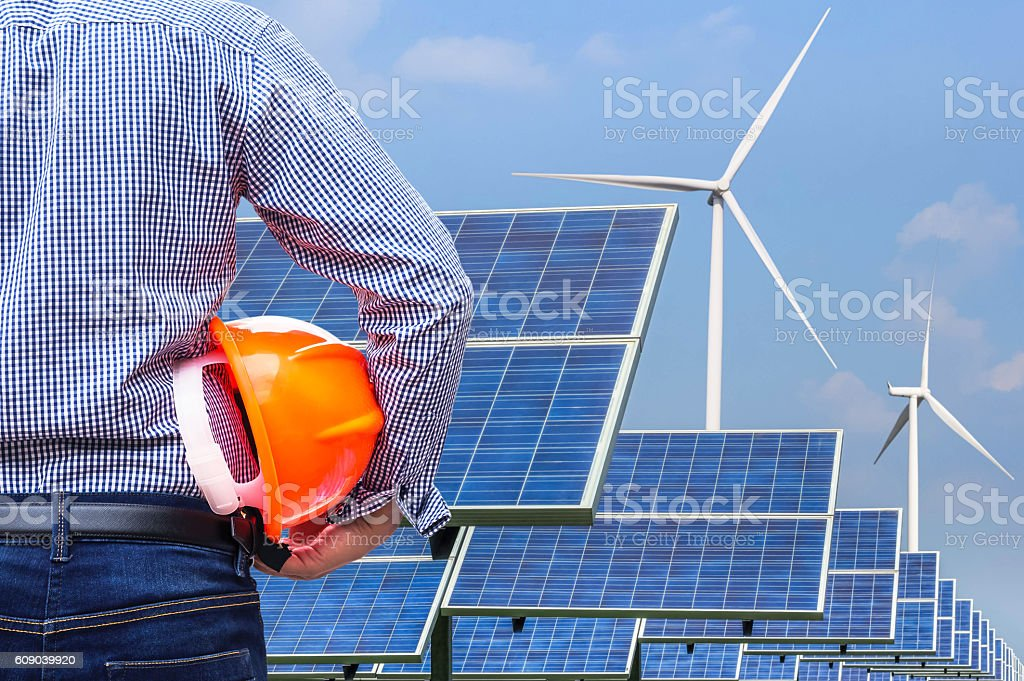 engineer holding yellow helmet front solar power station stock photo