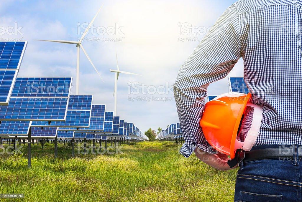 engineer holding yellow helmet in solar station stock photo