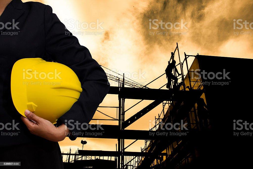 engineer holding Yellow helmet stock photo