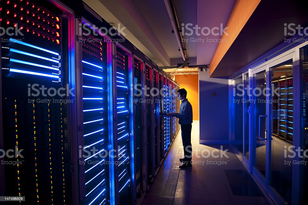IT Engineer in Action Configuring Servers royalty-free stock photo