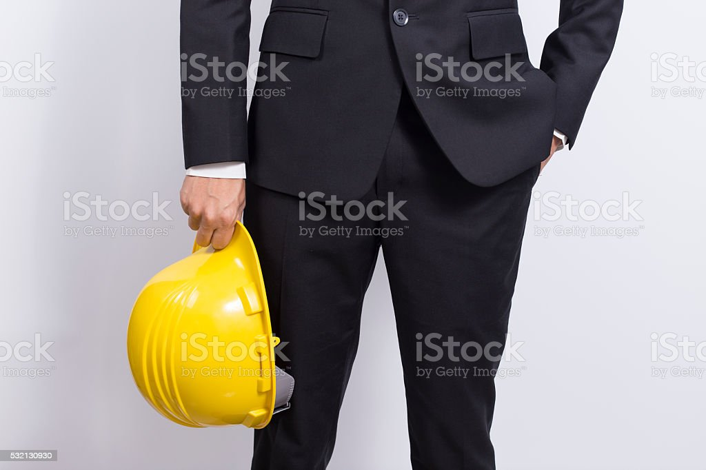 Engineer in black suit on isolated white background stock photo