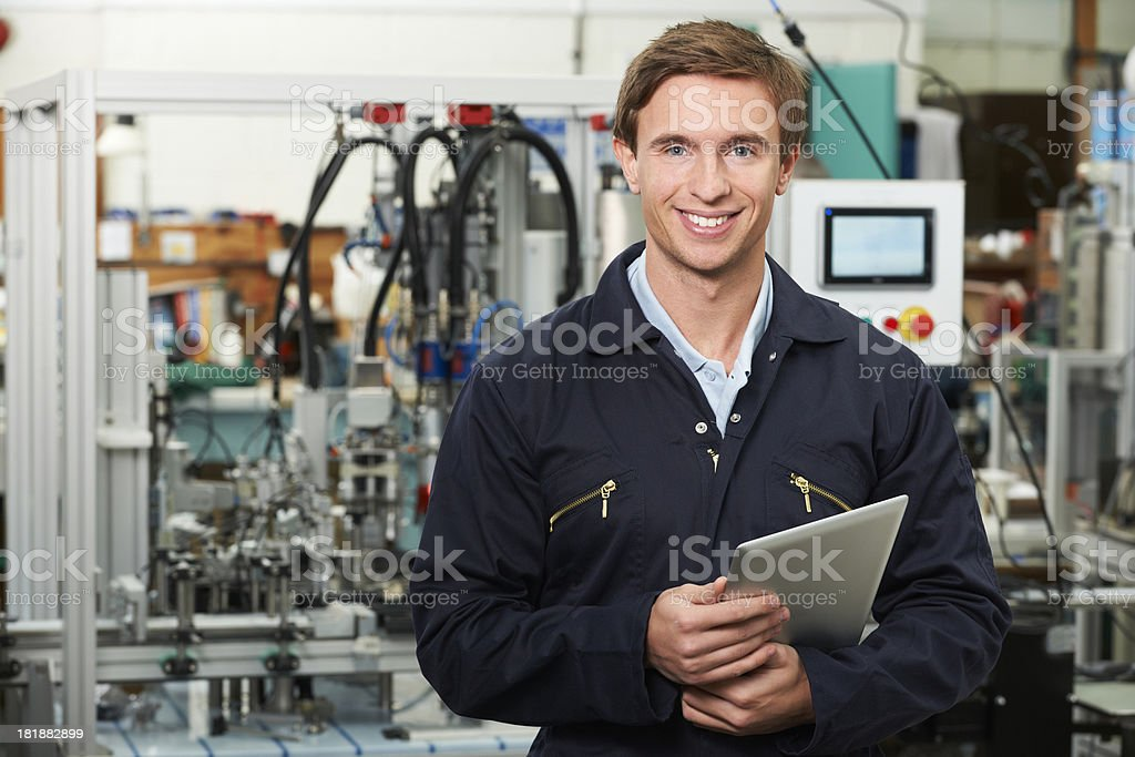 Engineer In Factory Holding Digital Tablet royalty-free stock photo