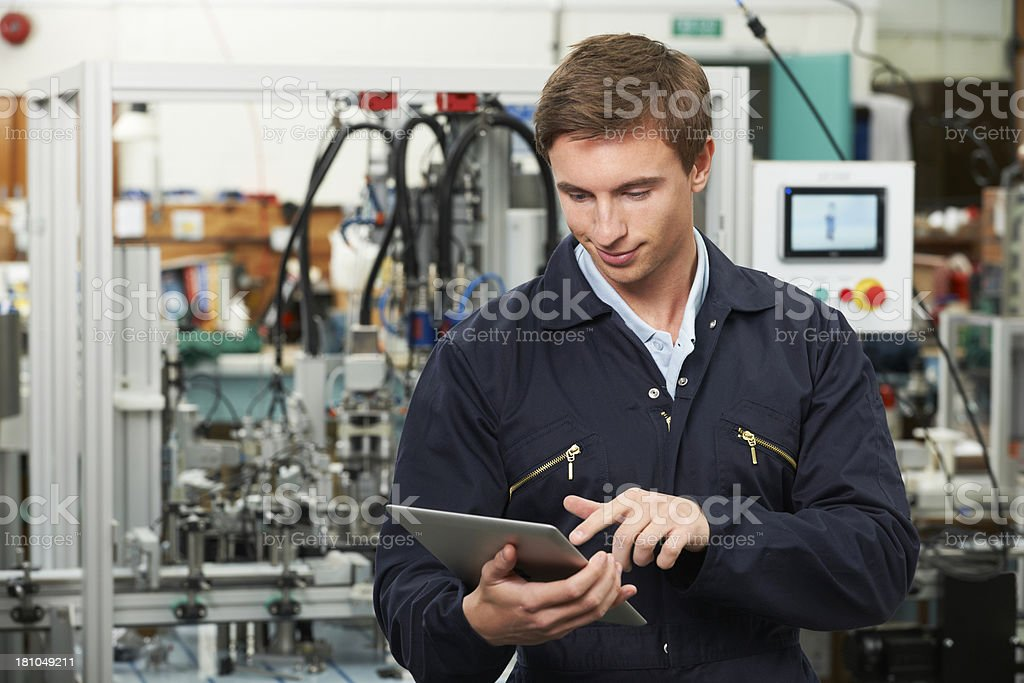 Engineer In Factory Using Digital Tablet stock photo