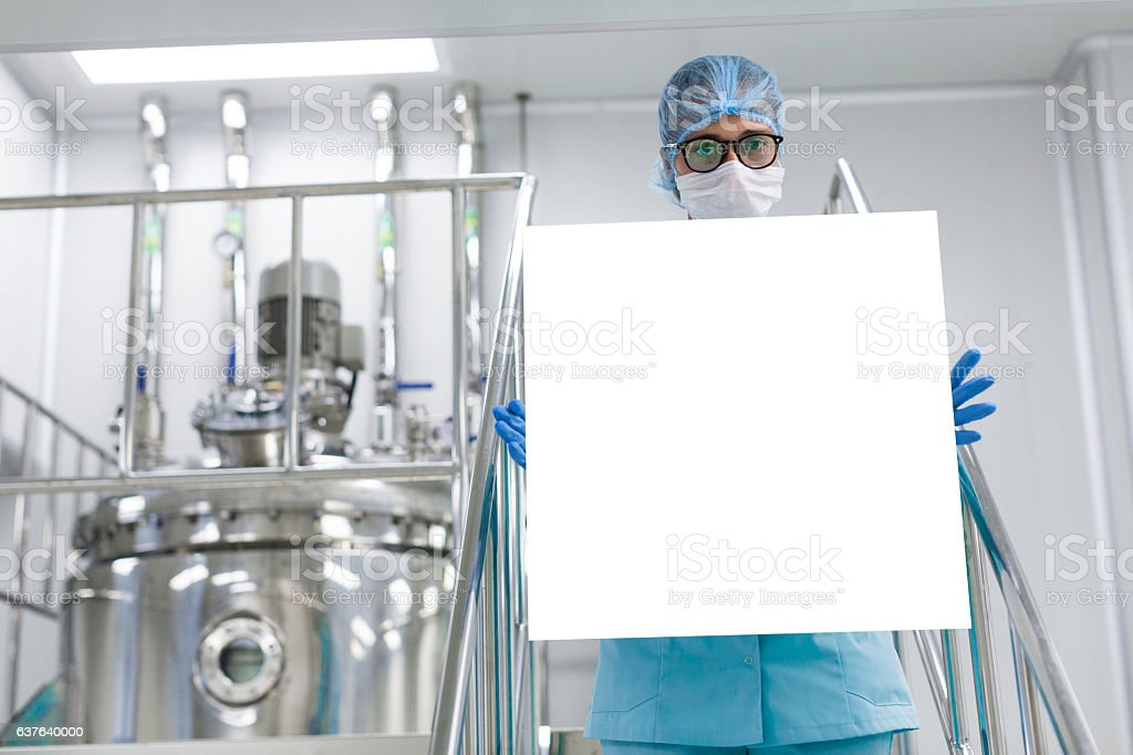 Engineer in the production of a tablet in hands stock photo