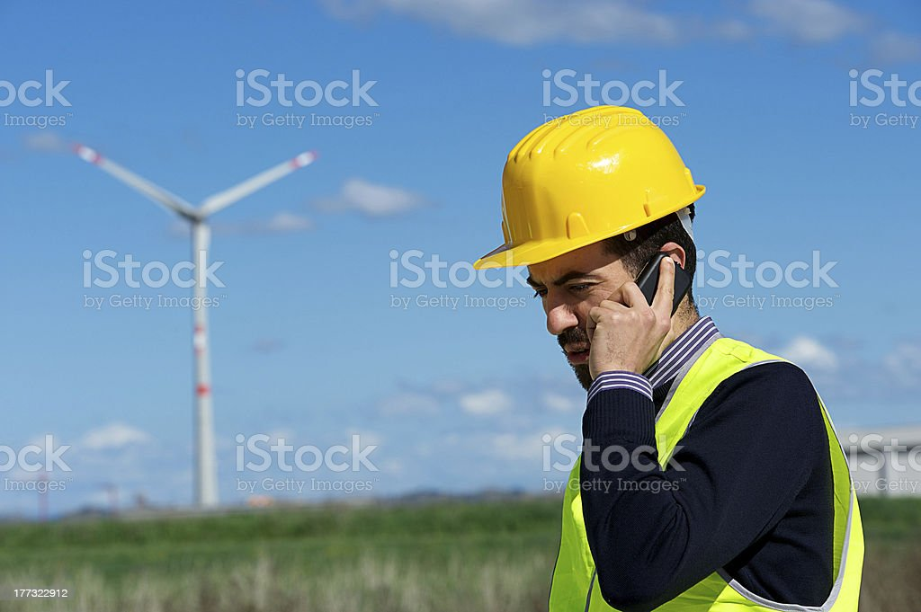 Engineer in Wind Turbine Power Generator talk at phone Station royalty-free stock photo