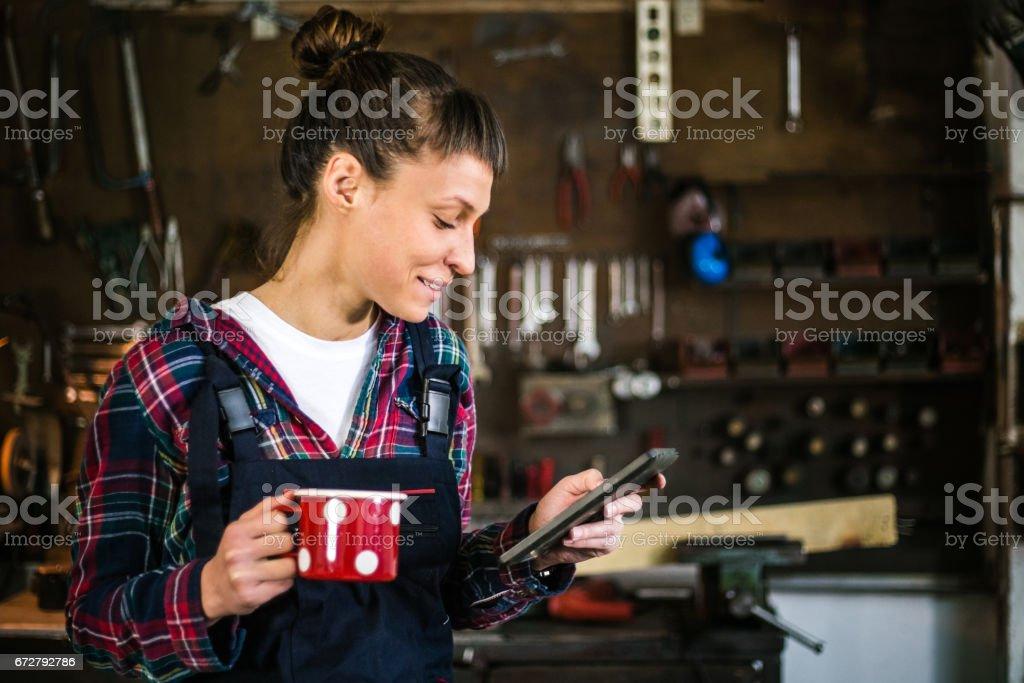 Engineer in workshop coffee break stock photo