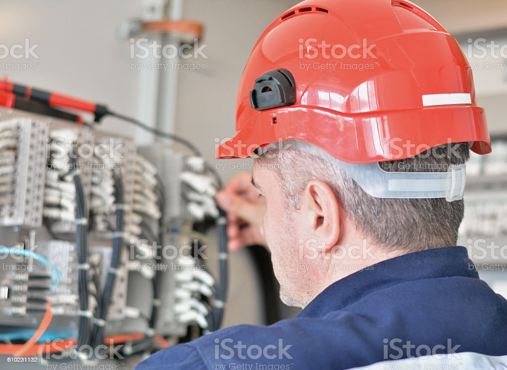 Engineer Inspecting Cabling Connection stock photo