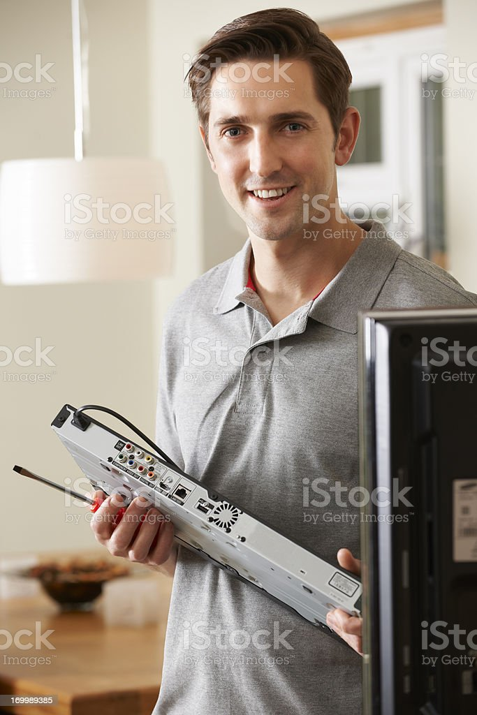Engineer Installing Digital TV Device royalty-free stock photo