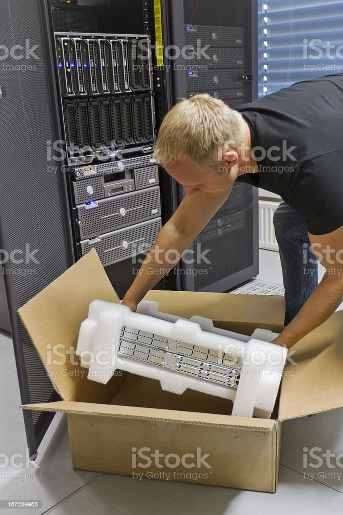 IT Engineer Installing New Router royalty-free stock photo
