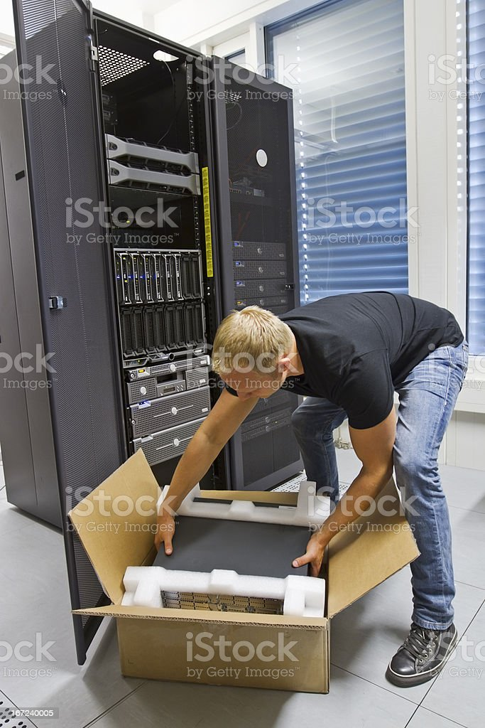 IT Engineer Installing New Server royalty-free stock photo