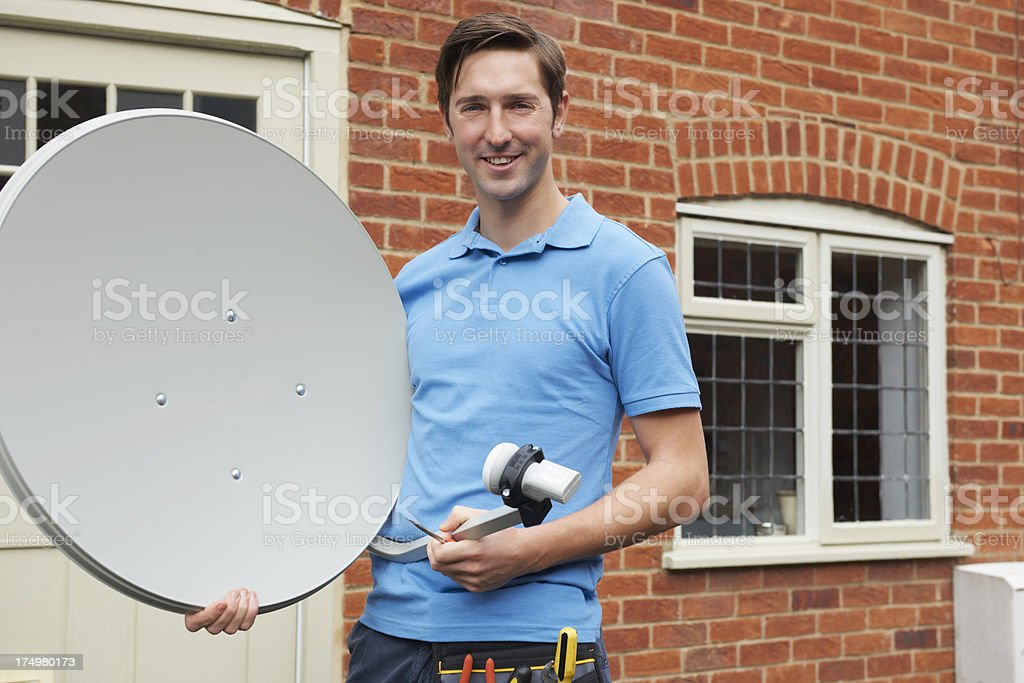 Engineer Installing TV Satellite Dish stock photo