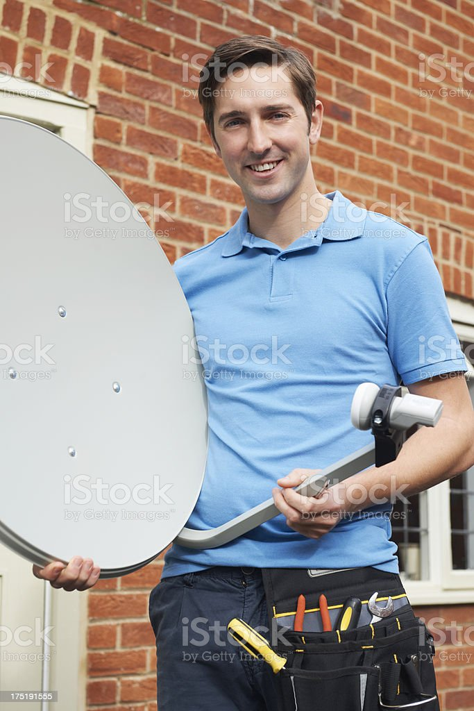 Engineer Installing TV Satellite Dish stock photo