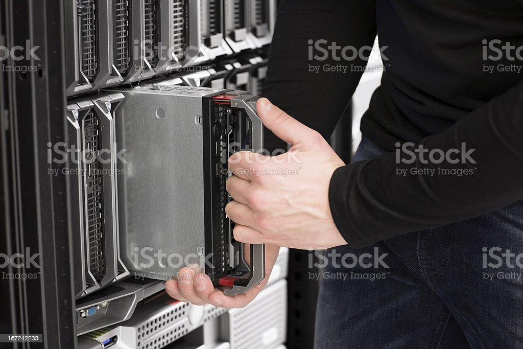 IT Engineer installs Blade Server in Data Center royalty-free stock photo