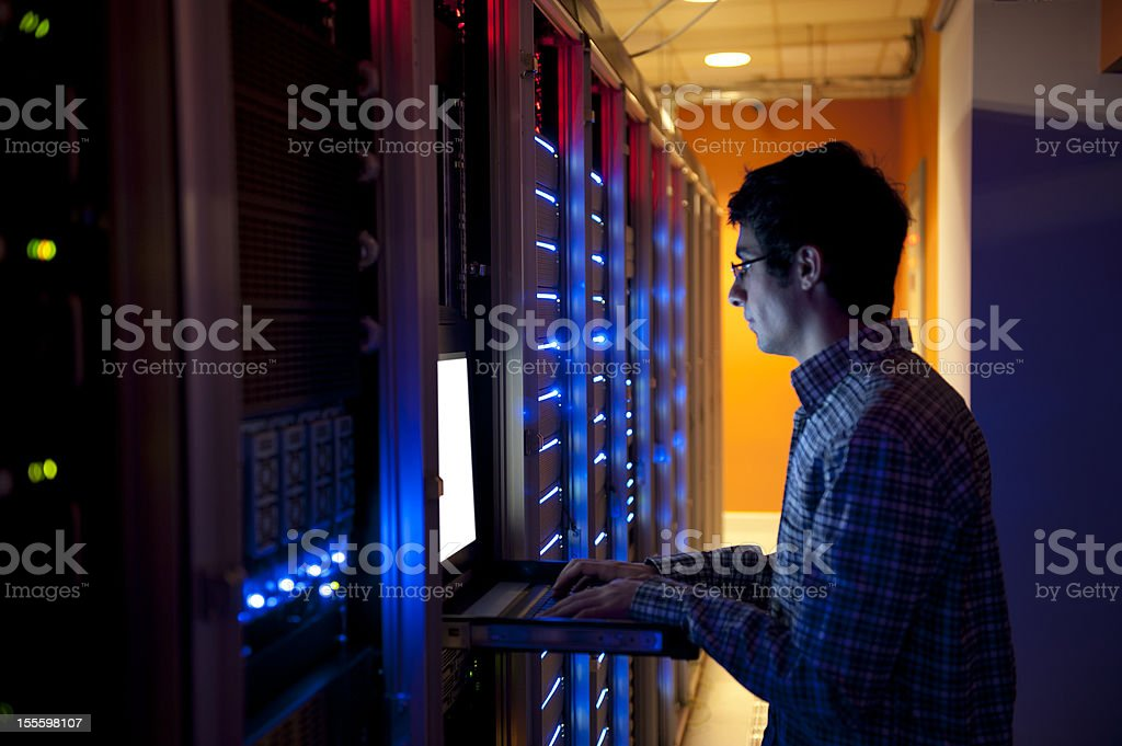 IT engineer is configuring servers royalty-free stock photo