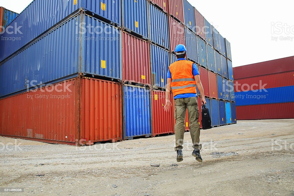 Engineer jumping of Cargo Containers stock photo