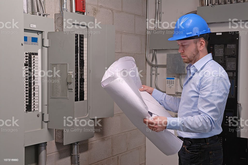 Engineer looking at plans royalty-free stock photo