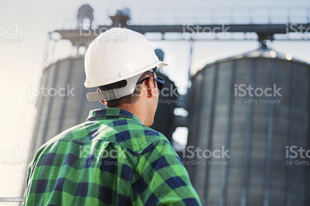 Engineer looking at silo tank royalty-free stock photo
