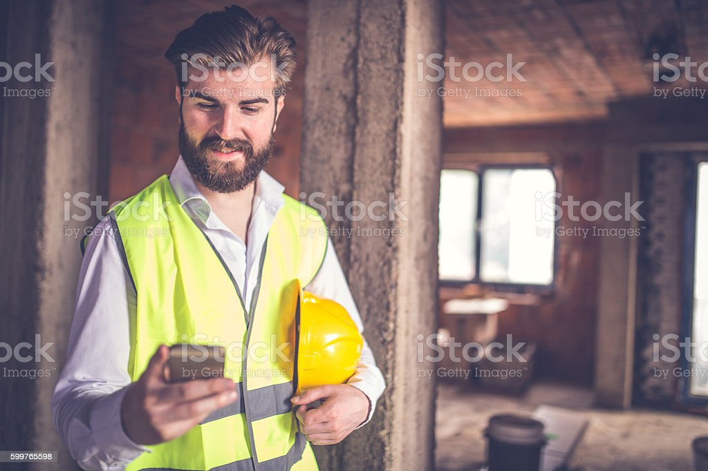 Engineer man at the construction site stock photo