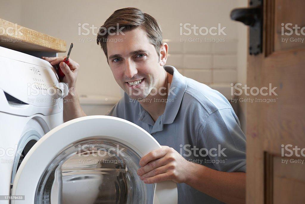 Engineer Mending Domestic Washing Machine stock photo
