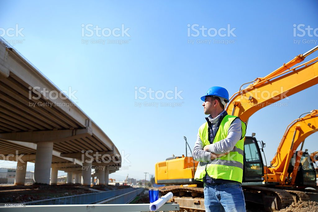 Engineer on highway construction site stock photo
