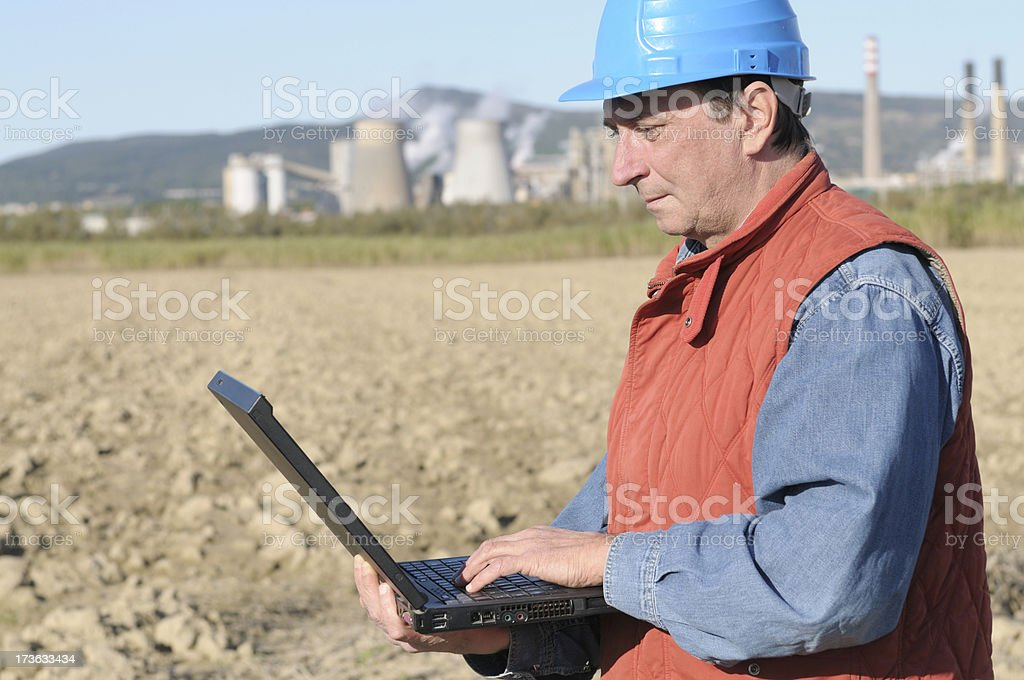 Engineer Planning PC and Chemical Plant royalty-free stock photo