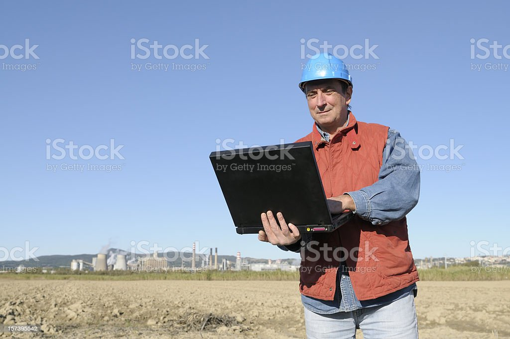 Engineer Planning PC and Chemical Plant.Copy Space royalty-free stock photo