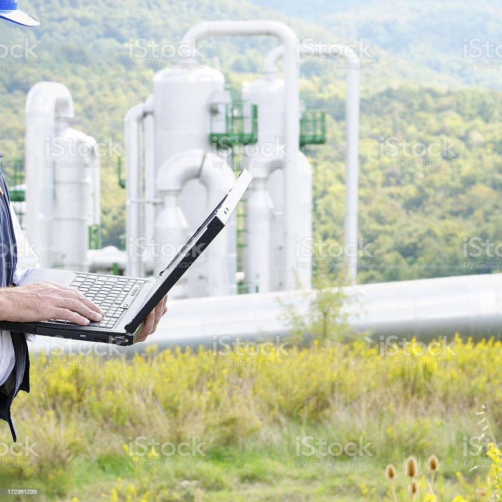 Engineer Planning PC and Geothermal Power Station royalty-free stock photo