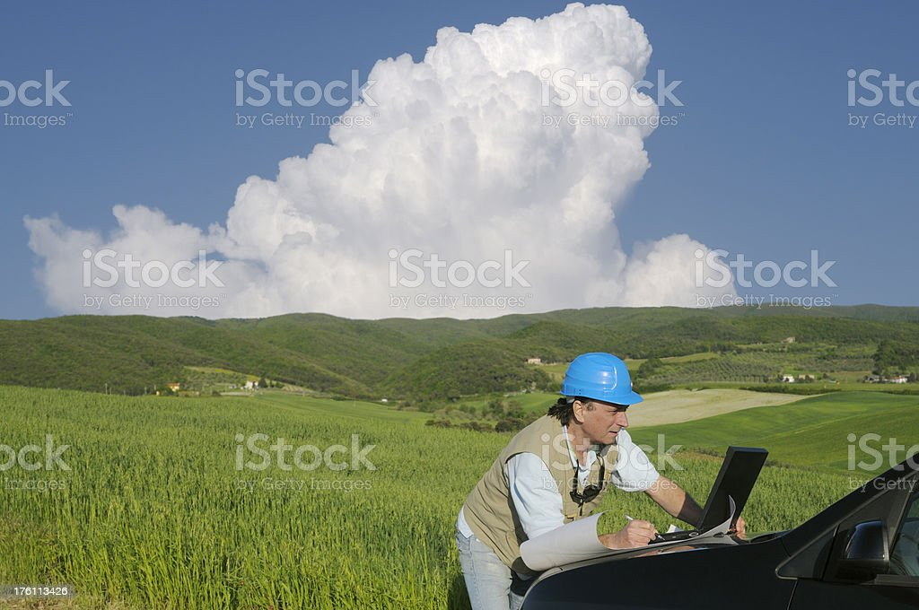 Engineer Planning PC in the Countryside royalty-free stock photo