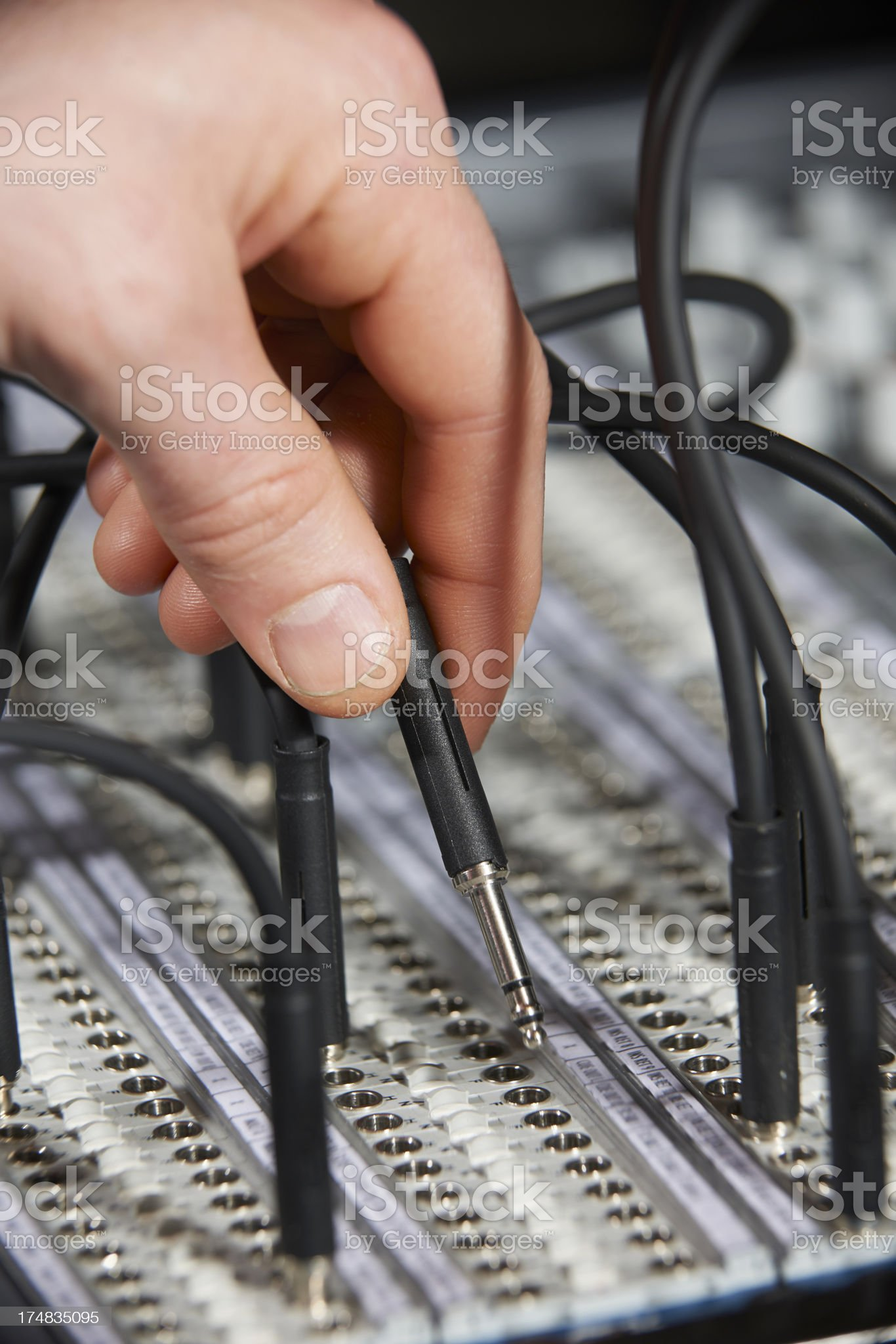 Engineer Plugging Cable Into Patch Panel royalty-free stock photo