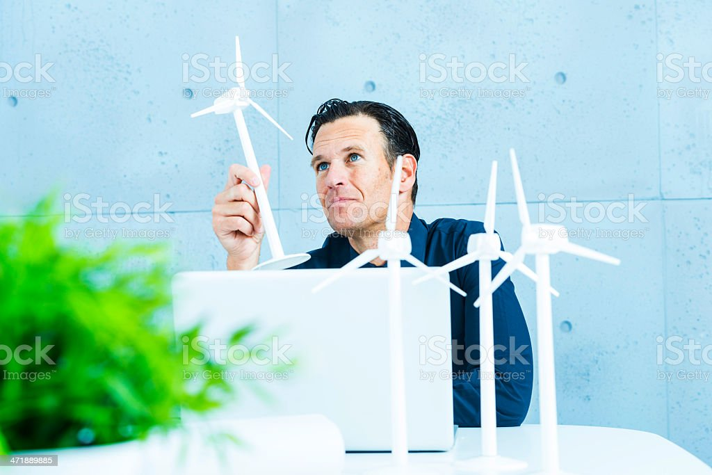 Engineer projecting wind turbines. royalty-free stock photo