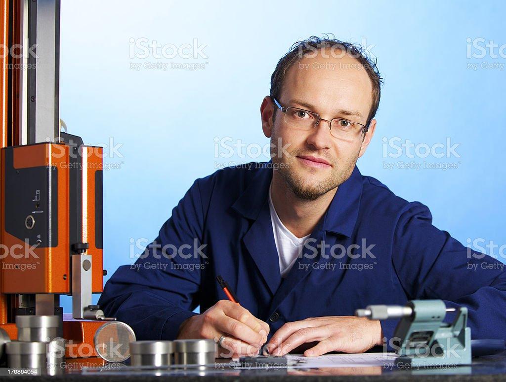 Engineer recording measurement data stock photo
