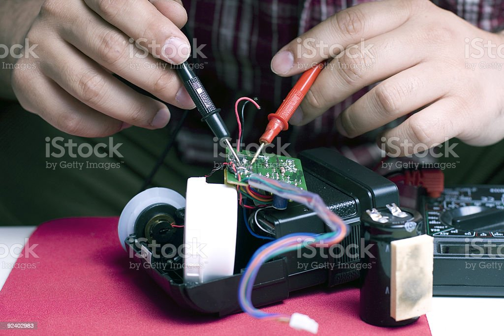 engineer repairing a flash unit stock photo