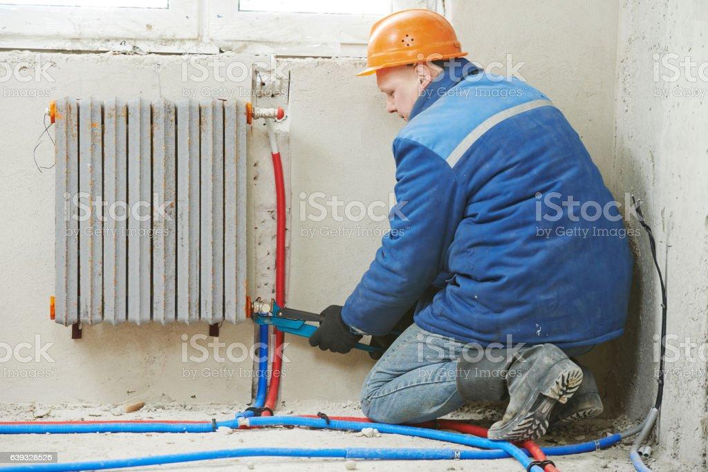 engineer repairmen installing heating system stock photo