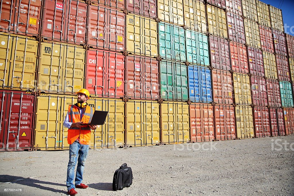 Engineer Stack of Cargo Containers stock photo