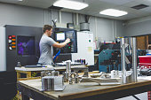 Engineer Students Learn to Use a CNC Lathe
