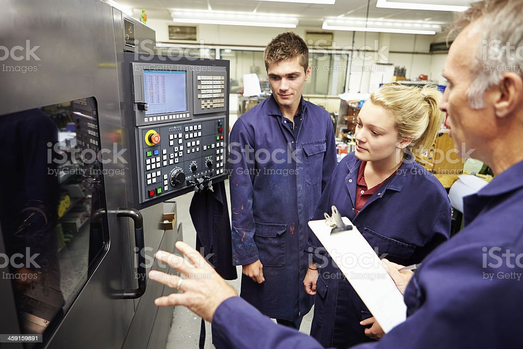 Engineer Students Learn to Use Computerized Lathe stock photo