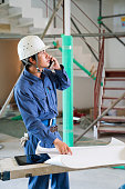 Engineer talking on a phone at building construction site