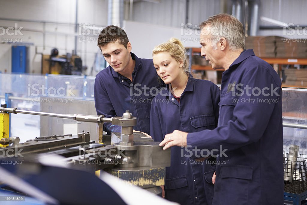 Engineer teaching about tube bending machine stock photo