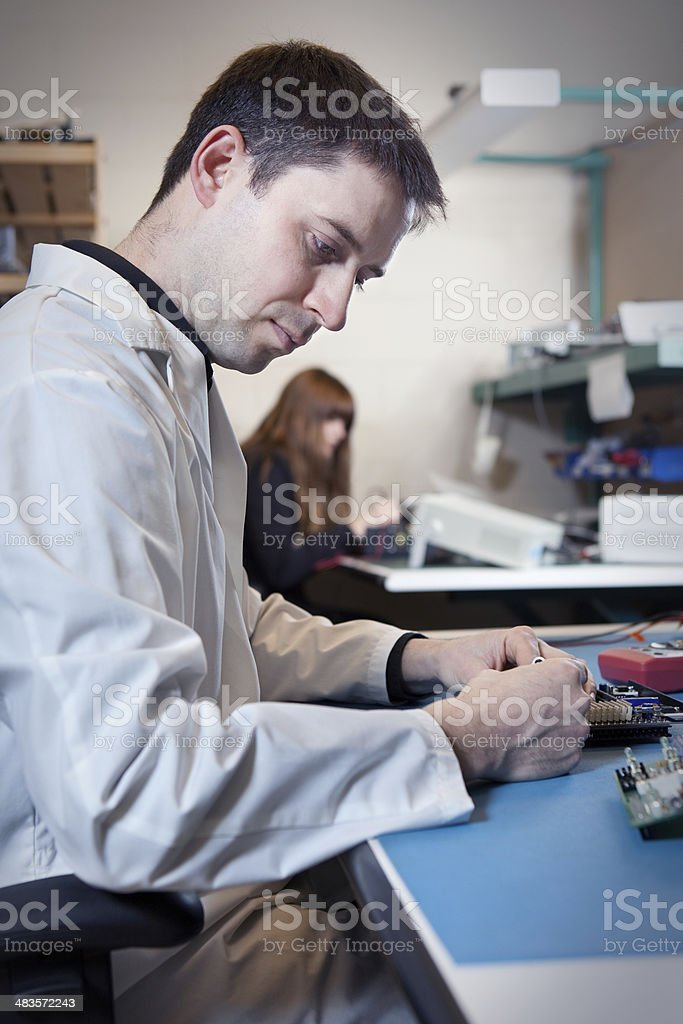 Engineer testing a circuit board assembly royalty-free stock photo