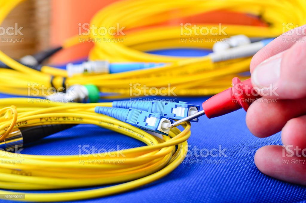 Engineer testing fiber optic cables. stock photo