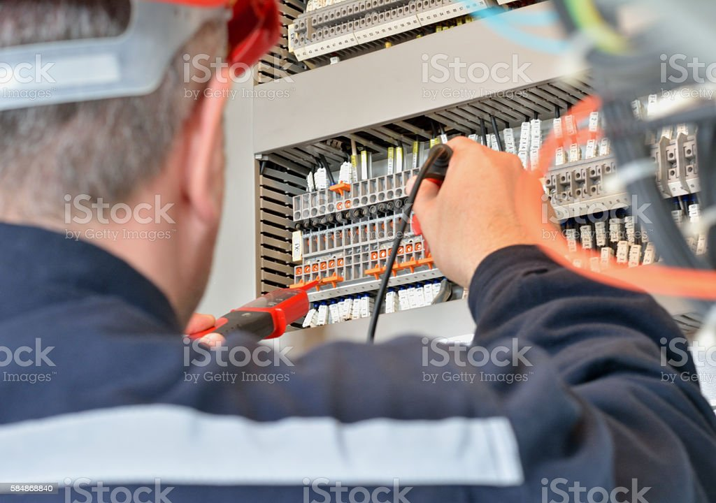 Engineer Testing for Voltage on Terminal Block stock photo