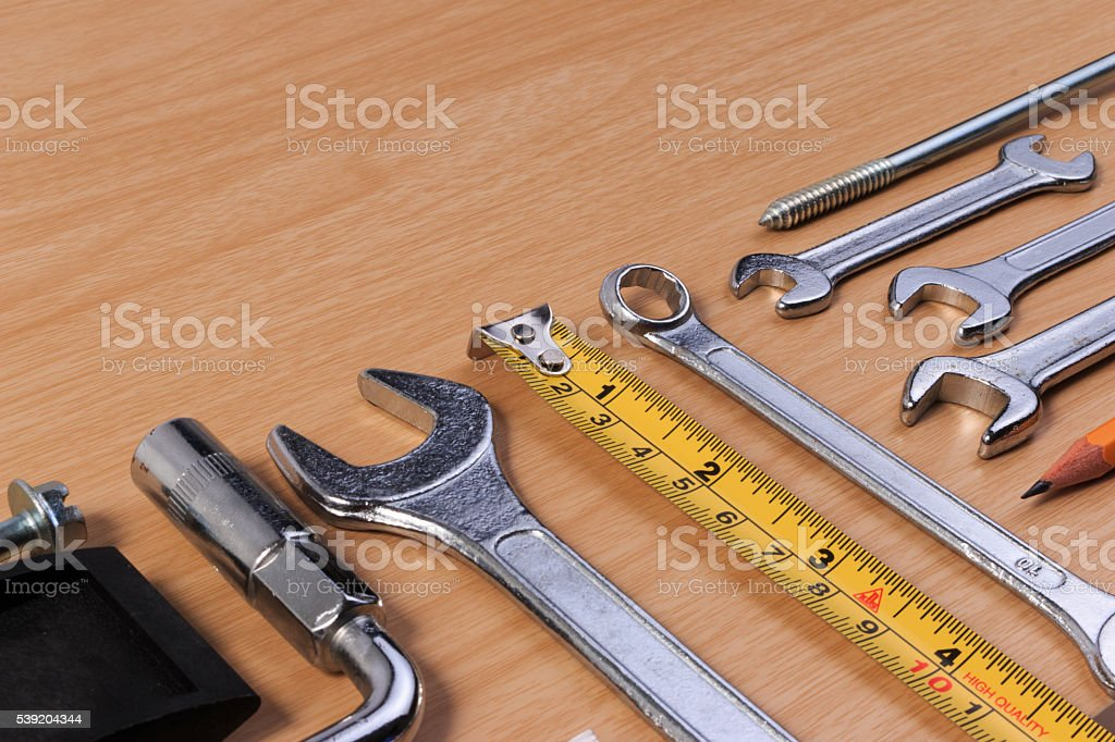 Engineer tools, wrench tools on wood table. stock photo