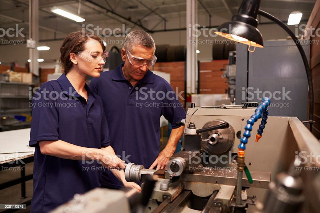 Engineer Training Female Apprentice On Milling Machine stock photo