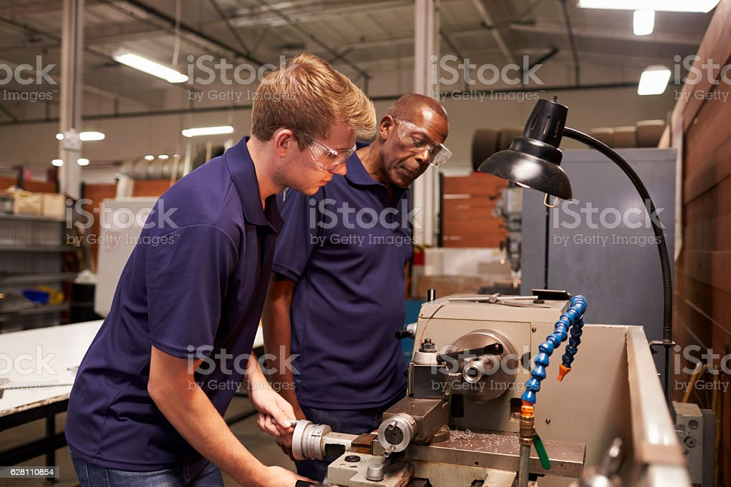 Engineer Training Male Apprentice On Milling Machine stock photo